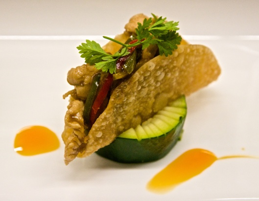 Sable & Rosenfeld teriyaki chicken taco placed on a zucchini ring with red daikon and cilantro sprout
