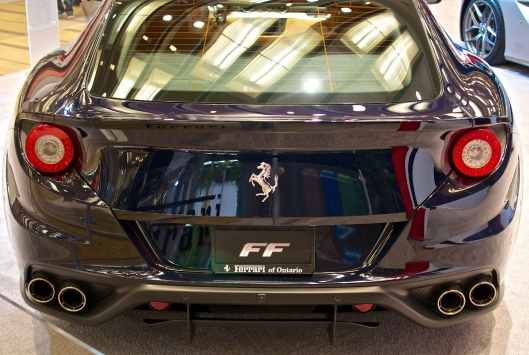 Ferarri FF. Four seats, four wheel drive.