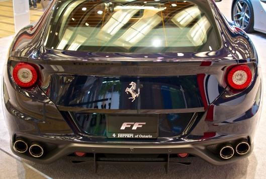 Ferarri FF. Four seats, four wheel drive.
