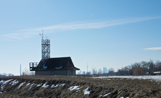 the often-photographed Leuty Lifeguard Station silhouetted against the Toronto skyline